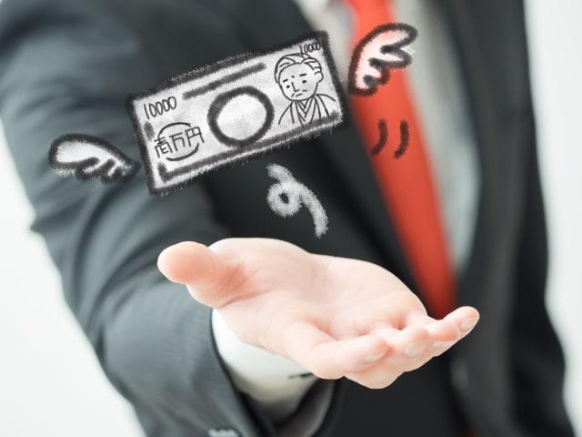 お札が手から飛んでいって出費がかさむことを表している